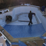 Aquaflex guys Site-Lining the pool.
